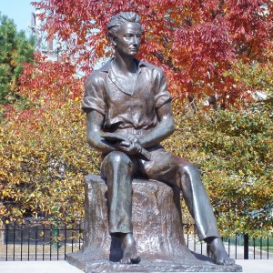 Sculpture of young Abraham Lincoln sitting on a stump